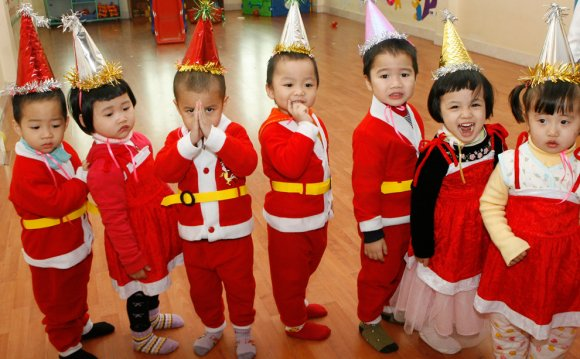 Children dressed in Santa