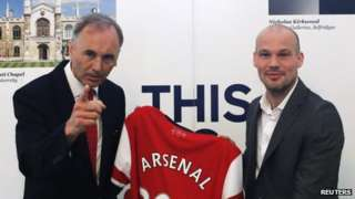 Arsenal club ambassador and previous player Freddie Ljungberg (right) and Uk ambassador to Japan Tim Hitchens pose with a jersey as Ljungberg encourages Arsenal's Asia tour within British Embassy in Tokyo on 7 June 2013