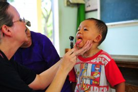 Lt. Cmdr. Laurel Christians, household nursing assistant professional, examines a Vietnamese kid's mouth during a pediatric assessment at a medical civic action system during the Phuoc Hoa secondary college meant for Pacific Partnership 2010.