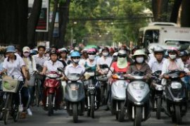 Many motorbike cyclists in Vietnam use masks to guard against dust and air pollution.