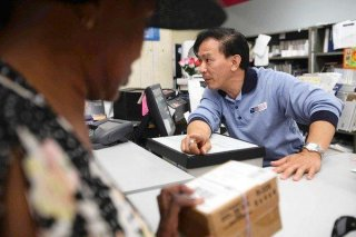 Postal staff member Raymond Tran is a large reason for the interest in the Little Saigon postoffice part in Westminster among those in the Vietnamese US community.