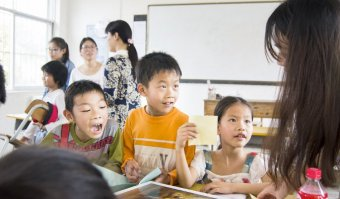 Teaching ESL in a class room with pupils in Asia