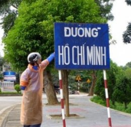 The sign says: Ho Chi Minh Road