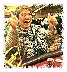 Vietnamese American woman betting in a casino © B